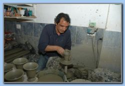 The potter Vagelis makes a Pythagoras cup