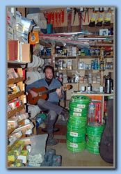 Panayotis playing and singing in his hardware store