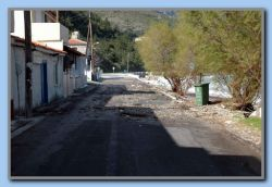 Kokkari, garbage on the road after big waves and heavy wind.