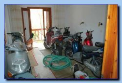 The scooters on Hotel La Plage are resting in room no. 2